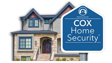 A house with a Cox Home Security yard sign in front